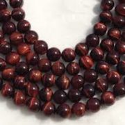 Red_tiger_eye_beads_by_ariyangems