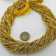 Plated_Golden_Pyrite_Tyre_Faceted_Beads_By_Ariyangems